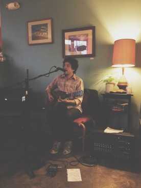 Joel playing a solo show at the shop.